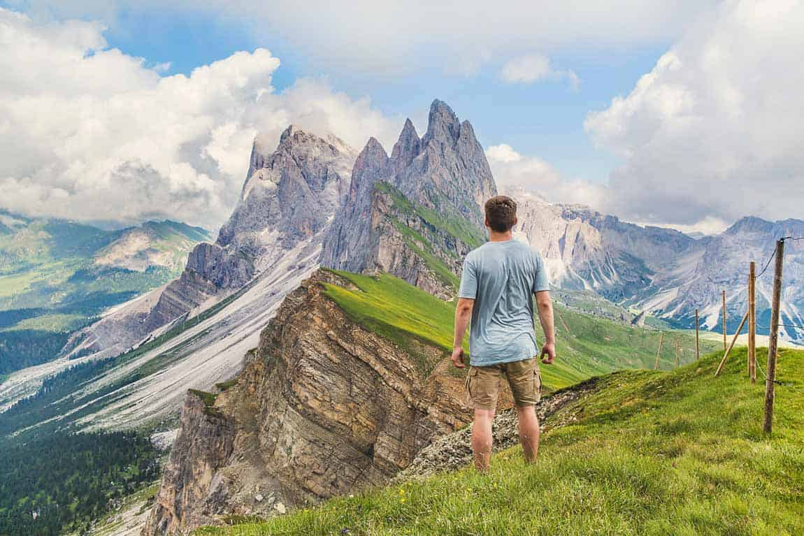 Man looking at beautiful mountain landscape. With WordPress.org, the sky's the limit.