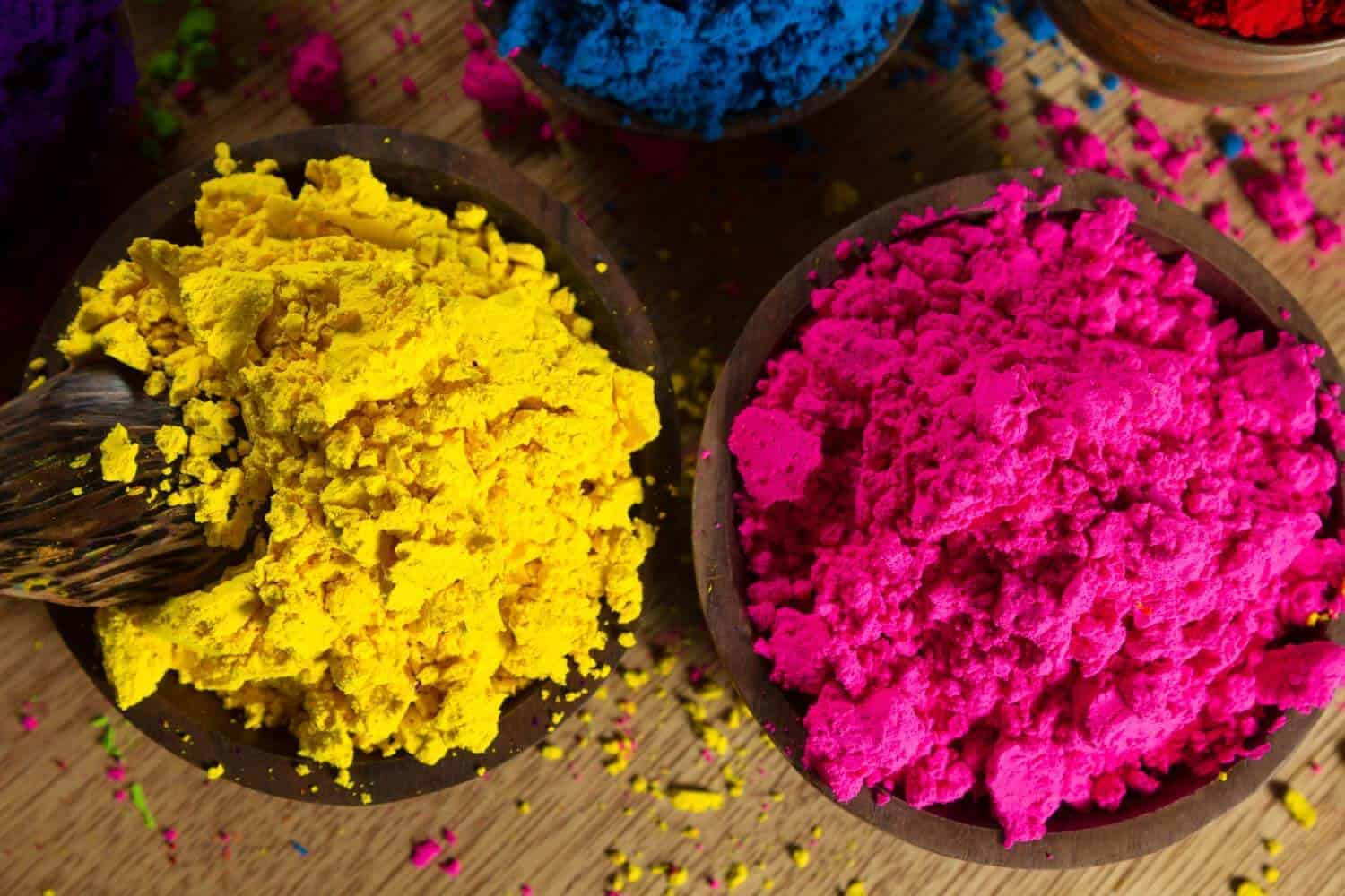 Indian pigments in magenta and yellow, representing colours in the CMYK colour system.