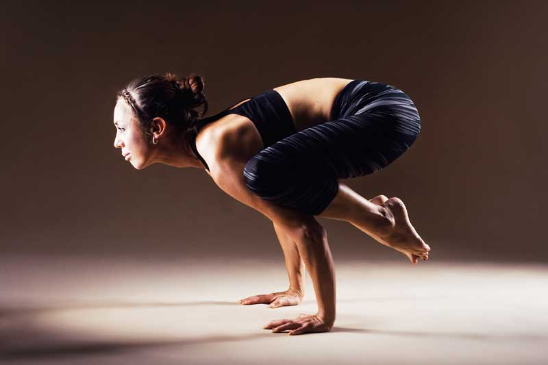 Bakasana, or crow, a challenging yoga pose. Writing, like yoga, is a skill that gets better with time, dedication and practice.