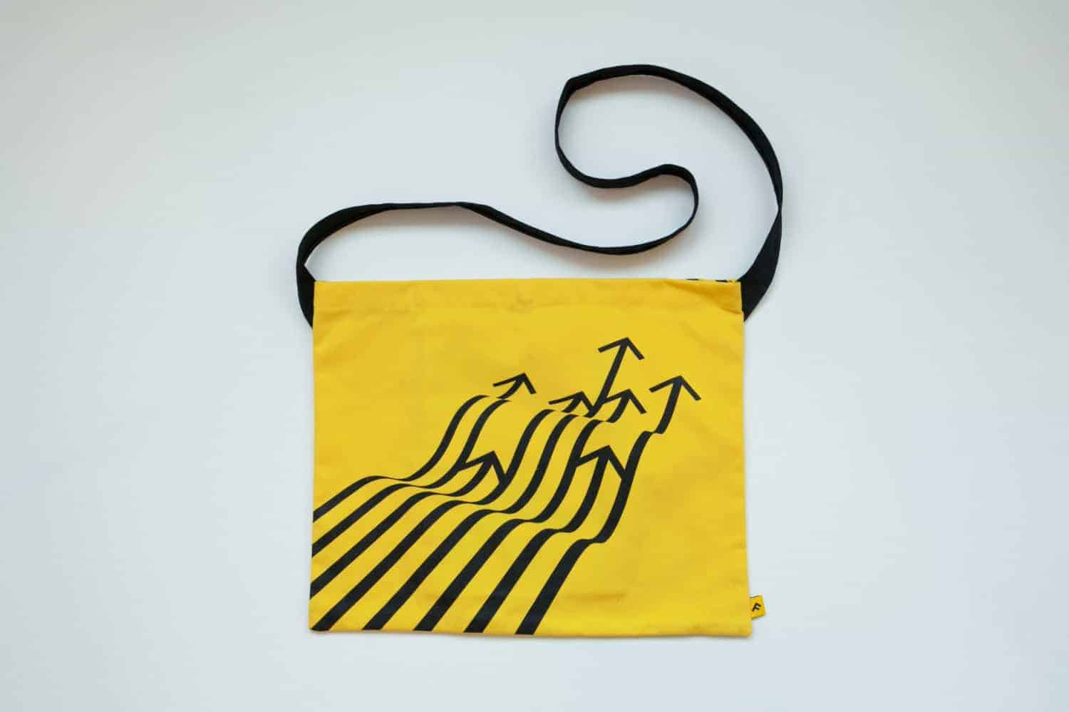 Design elements and principles. Design based on lines, by Tom Crabtree, on a yellow courier bag.