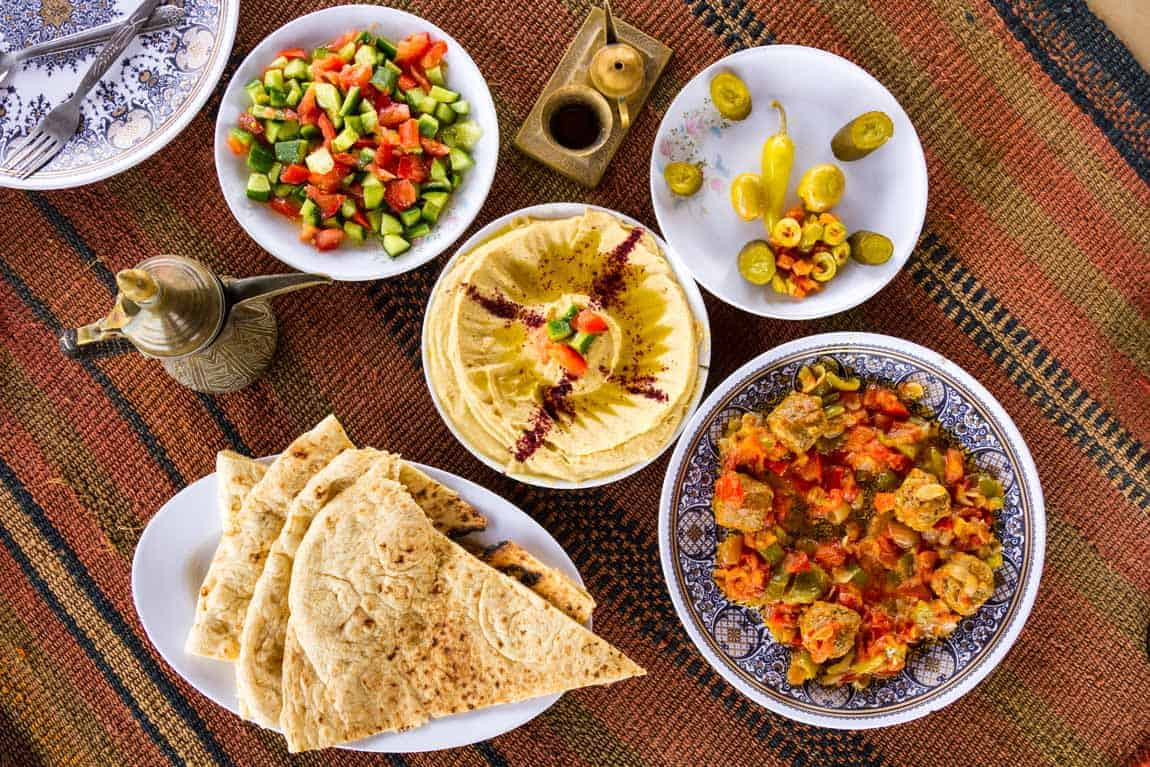 Middle eastern meal. Shared hosting is like sharing an abundant meal: plenty for everyone, when nobody is greedy. And when the host is generous, there will always be plenty more in the kitchen.