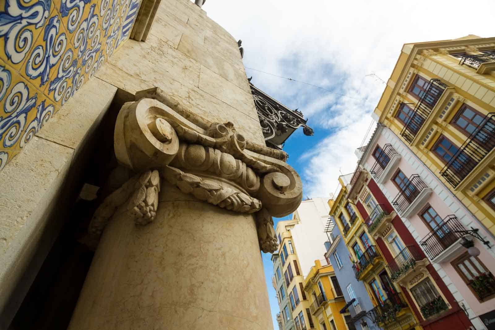 Valencia, home of good design and good food: a column on the side to the entrance to the Mercado Central, central market, in Valencia, Spain, The Mercado Central is a haven for foodies