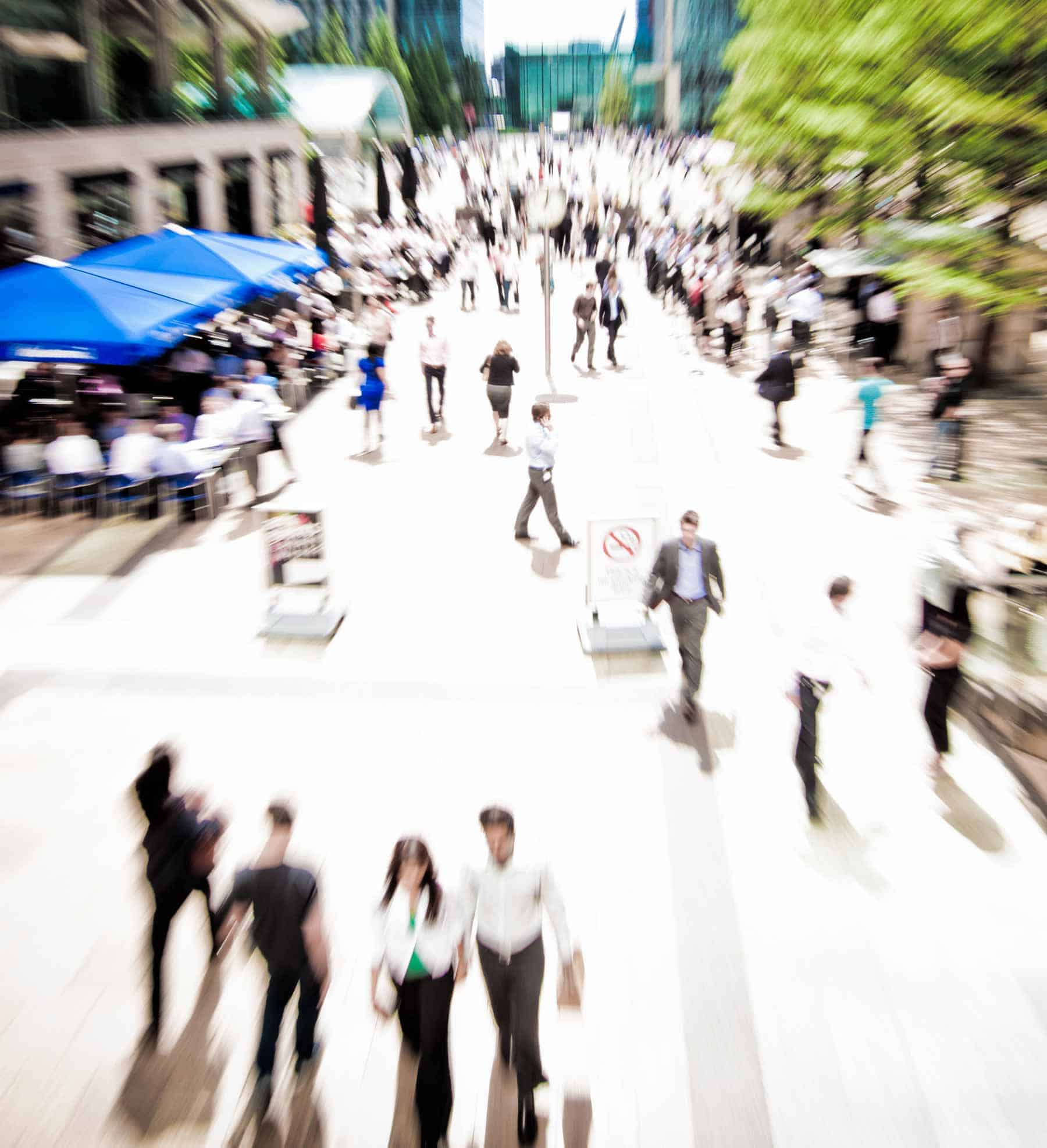 Business rush hour: people walking very fast in a city. Siteground will get your website to be faster.