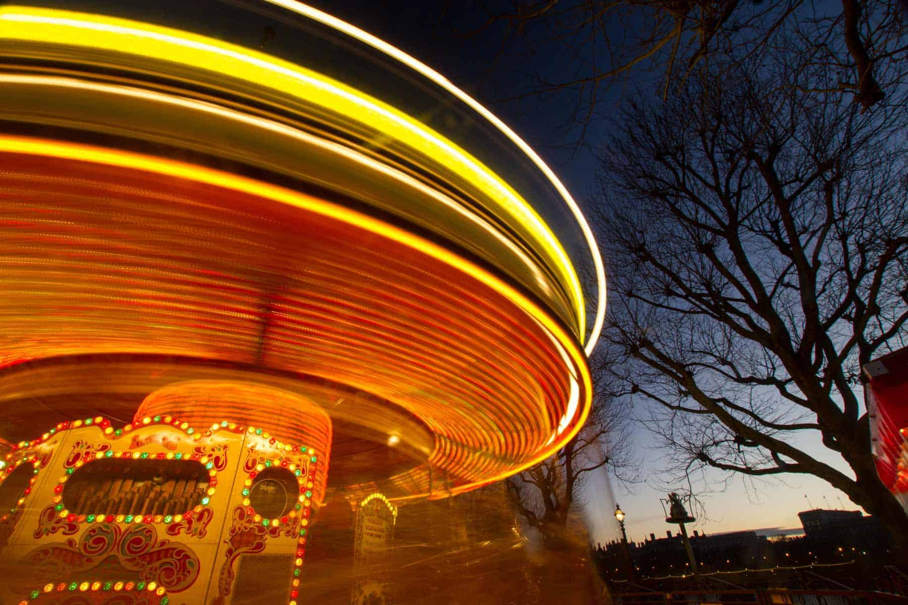 The light trails at a fun fair: beautiful and engaging.