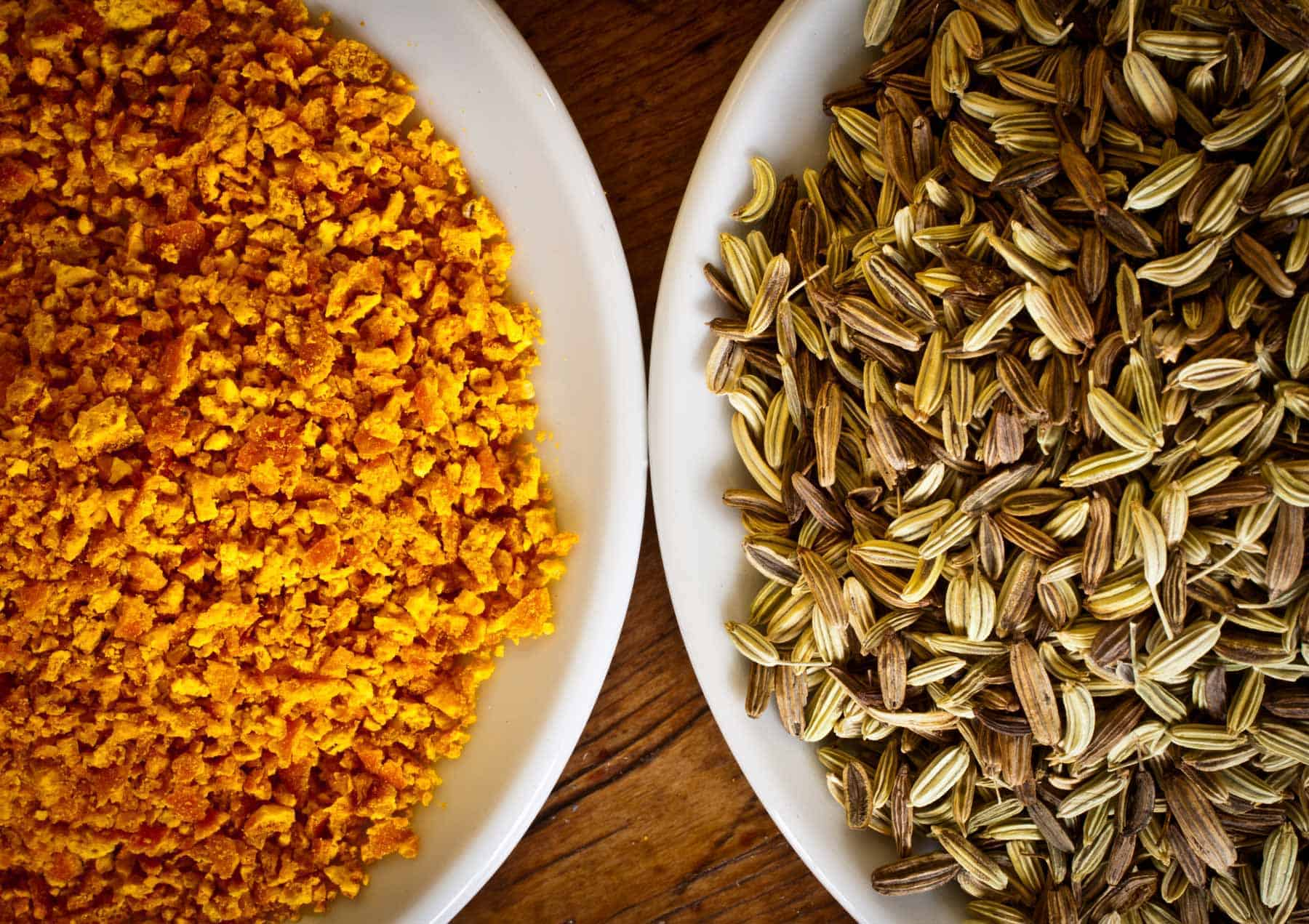 Orange and fennel seeds on two plates. The difference between WordPress.com and WordPress.org.